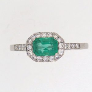 Pre Owned Emerald And Diamond Cluster ring